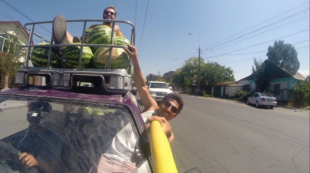 When your travel mate proposes loading up your car with as many watermelons as can fit and handing them out to everyone you pass on the streets of Kyrgyzstan, just run with it.