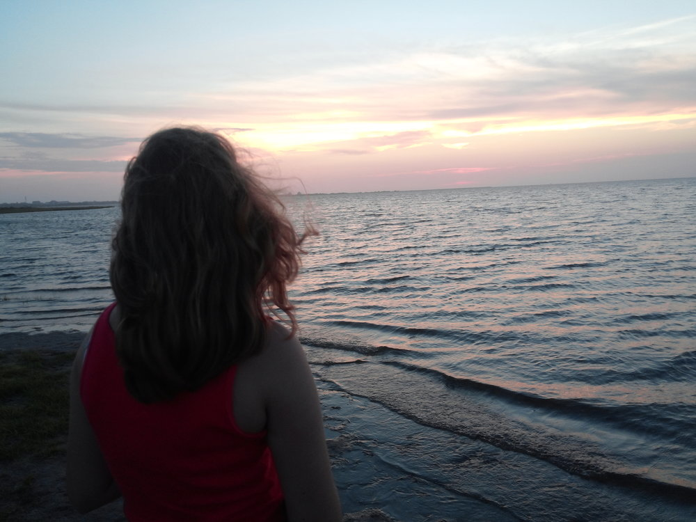 My beautiful baby sister looking out at the sunset over the Pamlico Sound