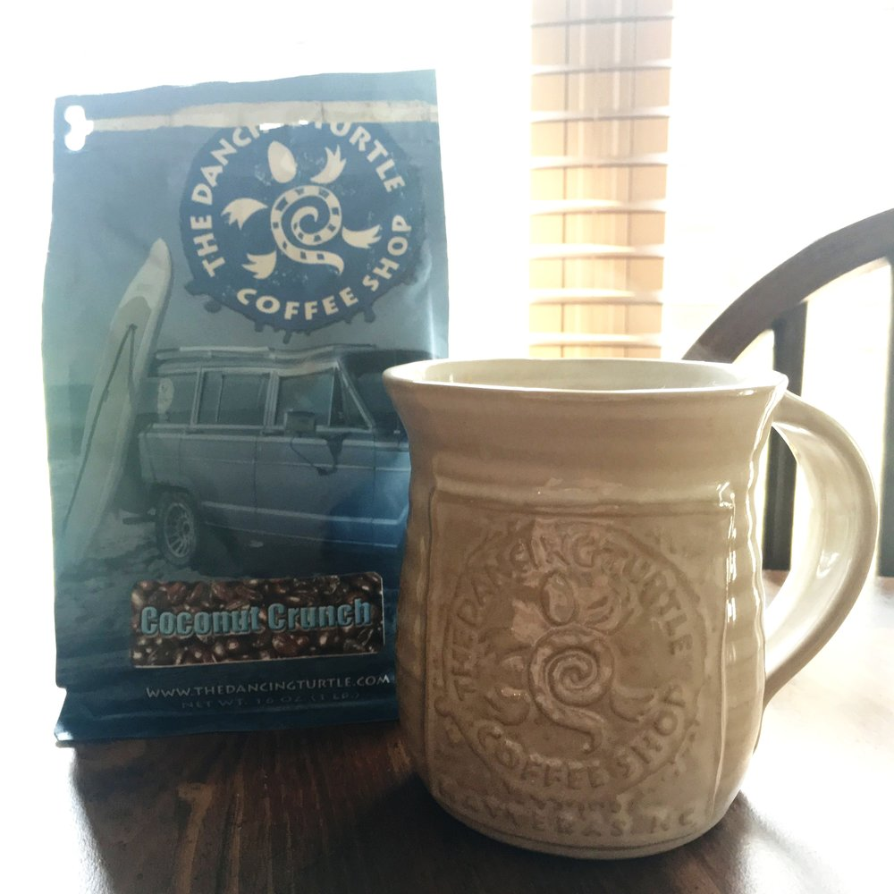 The coconut crunch coffee and the hand-made pottery mug that I bought at the shop during vacation.