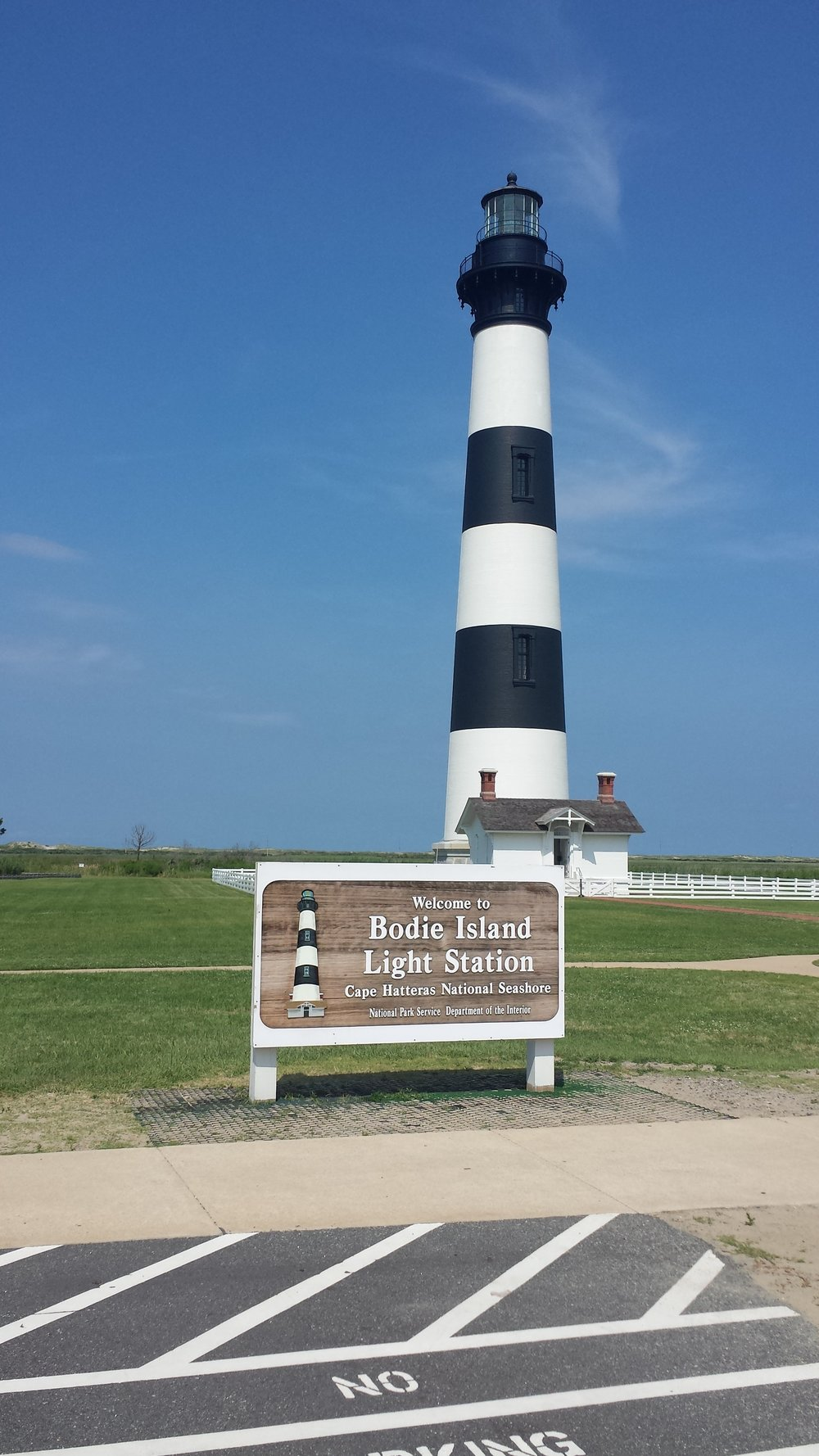 Most of the famous lighthouses [like Bodie Island  Light Station, pictured] are run by the National Park Service.
