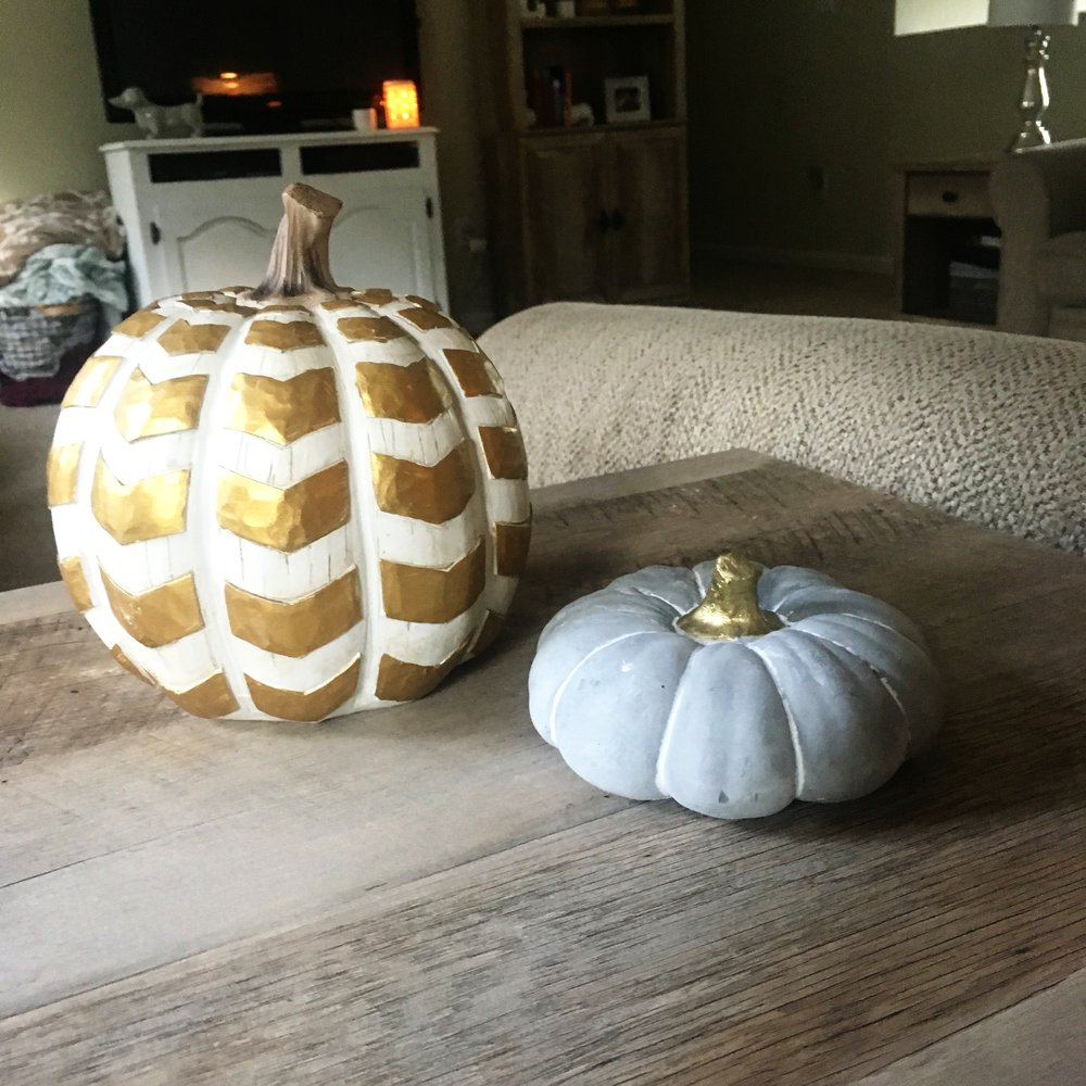 white carved pumpkin with gold chevrons &  pumpkin with gold stem  - From the Robert Stanley Signature Collection for Hobby Lobby. I will put these on my bookshelf! - $17.99 & $4.99 [40% off]