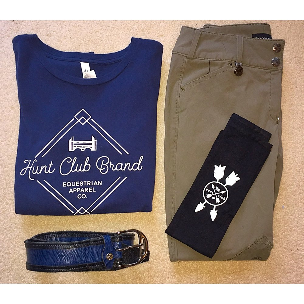 Shown: Hunt Club Long-Sleeve Jump Crew Tee, Beige Pikeur Breeches, Hunt Club Logo Boot Socks, Hadfield's Belt.