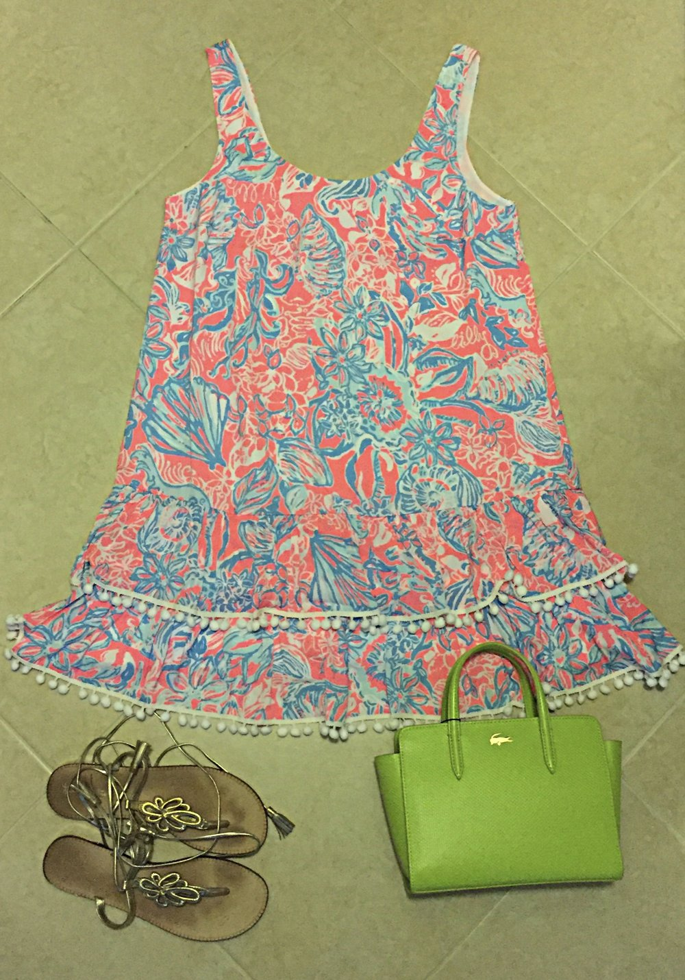 Shown: Lilly Pulitzer dress, Lilly Pulitzer shoes, Lacoste bag.