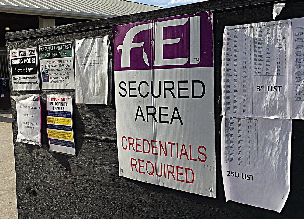 The entrance to FEI stabling. This board houses rider and horse lists, schedules, and some rules that anyone involved with horses competing in international classes must abide by.