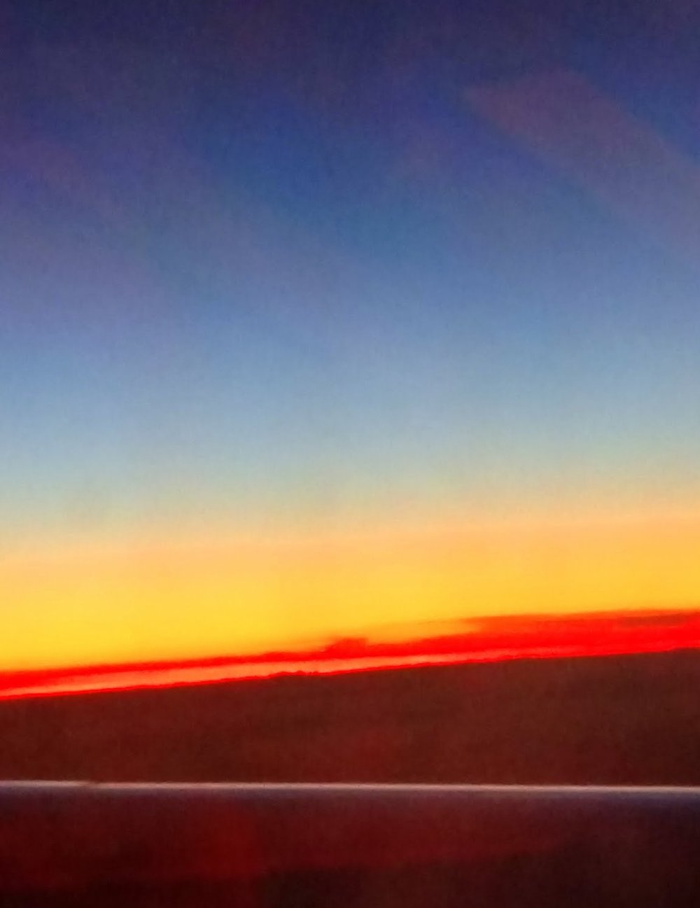 Sunrise over the Spanish Countryside at 12:43 AM EST Like a lake of fie, awe inspiring!