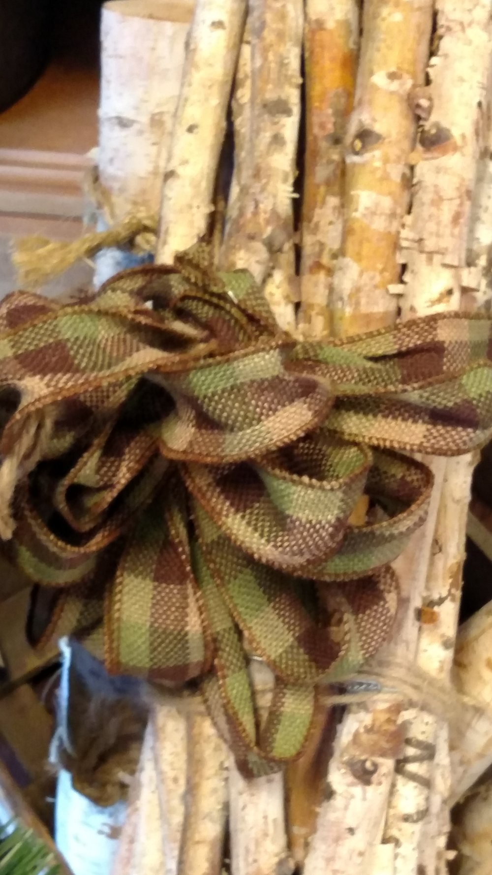 Bundle of Fire Wood Tied neatly with a Tartan Plaid Bow