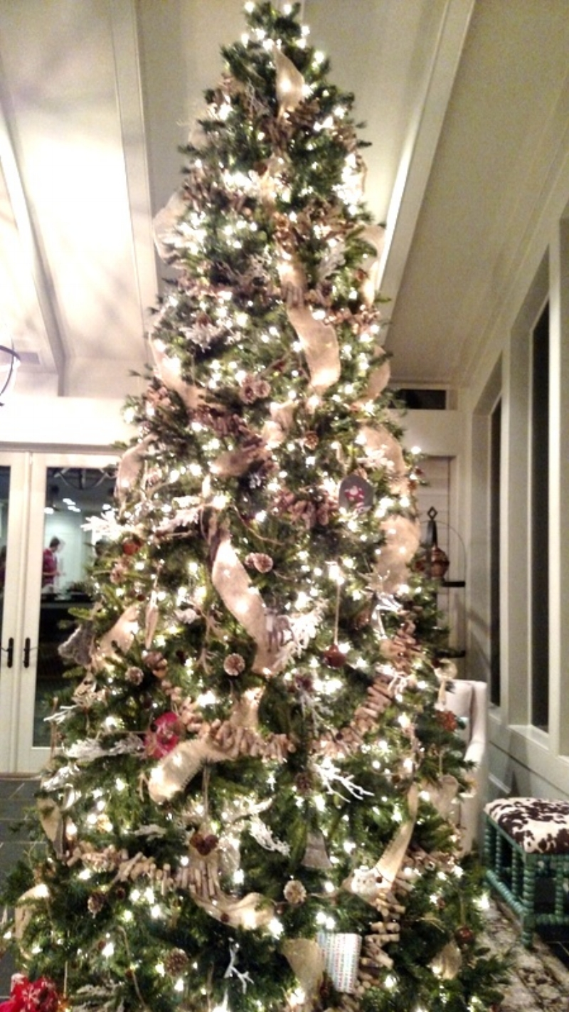 A soaring Christmas Tree with ribbons and rustic touches