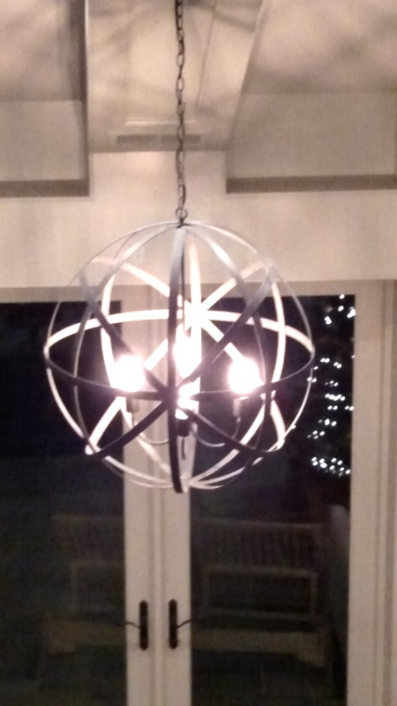 Beautiful Orb light fixture hanging from the Vaulted Ceiling