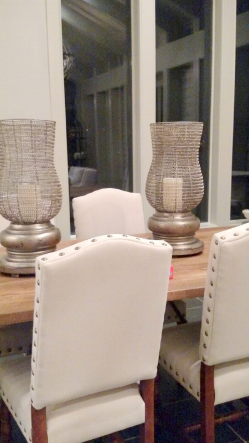 Farmhouse table with Natural Linen covered Chairs and Nailhead Trim