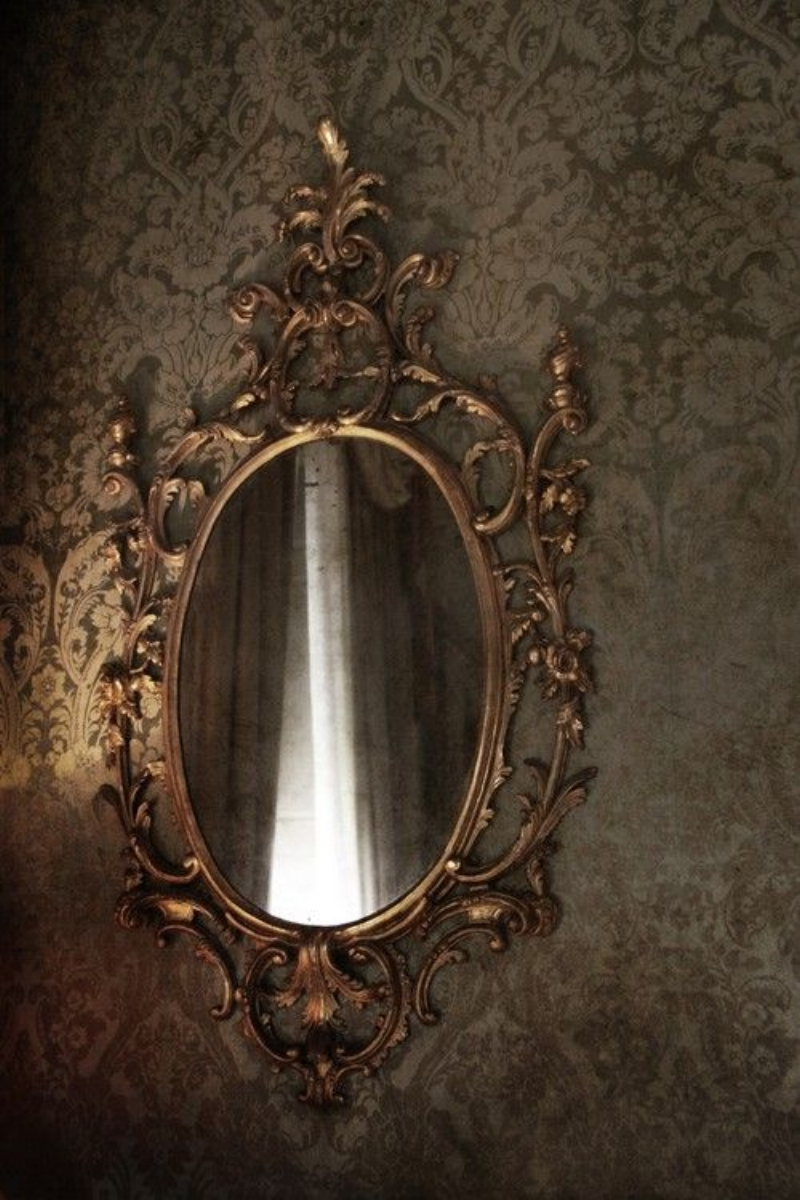 Ornate Gold Mirror with Tone on Tone Taupe Wallpaper via abyweb.com