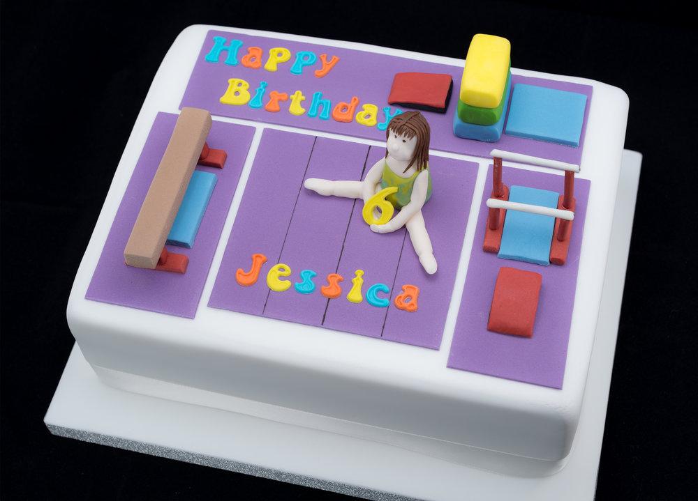 A Gymnastics themed cake made to match Jessica's gym club.