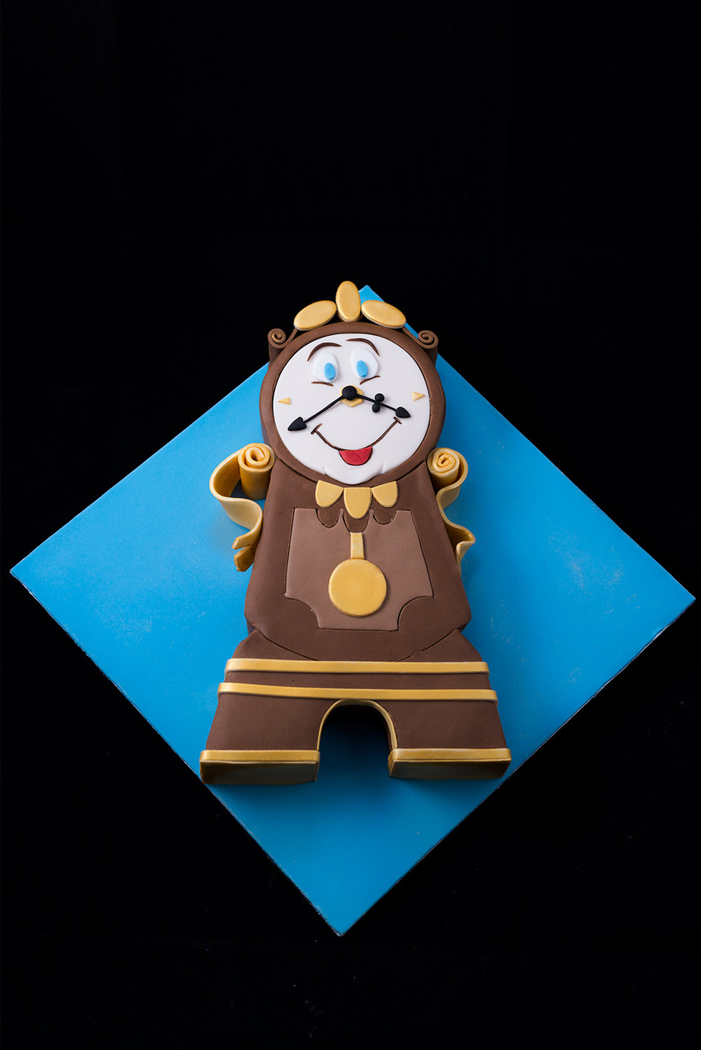 To celebrate the new adaption of Beauty & The Beast, here's our Cogsworth Cake.