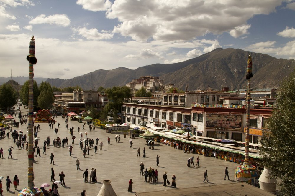 Jokhang plaza with the Potala  palace in the distance.