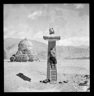 The image is by Hugh Richardson, showing his Tibetan assistant taking rubbings from the Karchung (skar cung) pillar. The photos are at The Pitt Rivers Museum, Oxford
