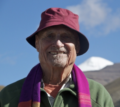 Bebe at 78 has just completed 53 km at 18,500 feet - Mt Kailash behind him