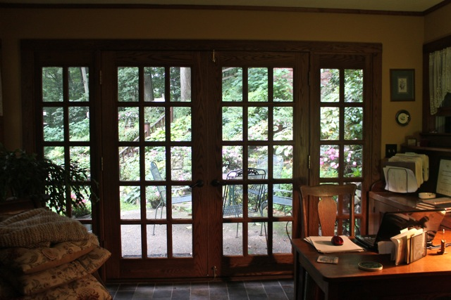 French doors lead to the patio and beautiful terraced garden beyond.