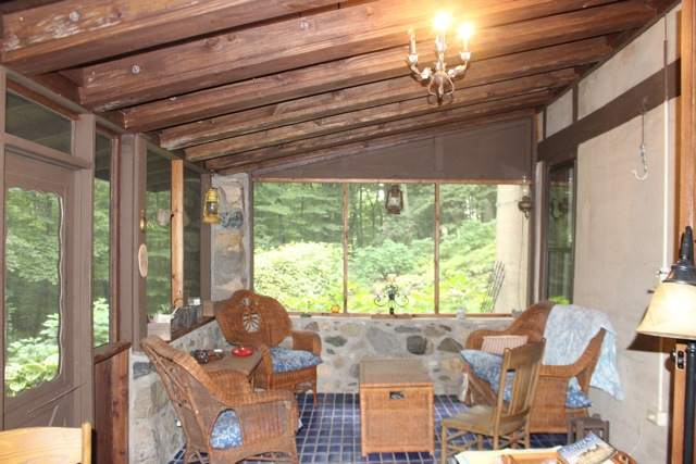 Interior of the fieldstone porch where we sat comfortably and chatted some more...