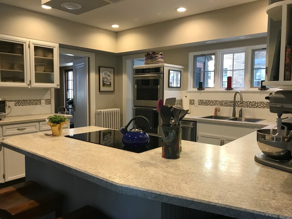 MODERN NEUTRAL KITCHEN WITH LOW CEILING FITTING THE COTTAGE STYLE