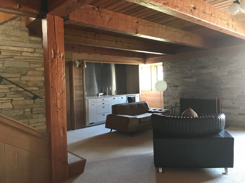 FAMILY ROOM WITH HAND-HEWN BEAMS