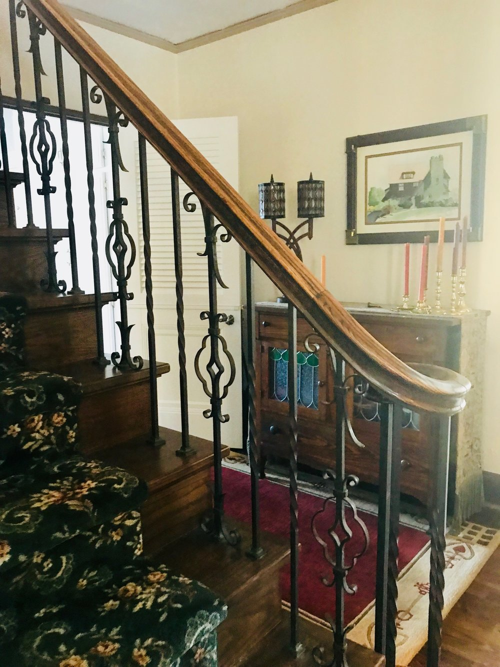 DECORATIVE WROUGHT IRON RAILING IN THE STAIR HALL