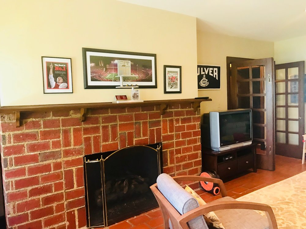 ORIGINAL BRICK FIREPLACE IN WALKOUT LEVEL