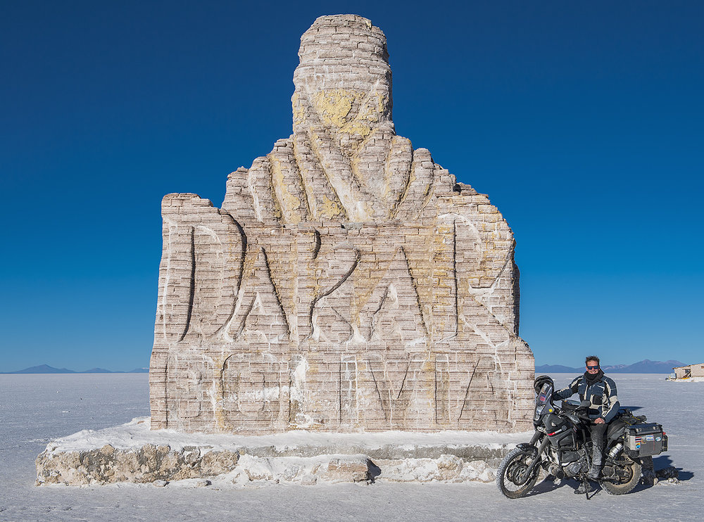 at the Dakar Rally monument in Bolivia