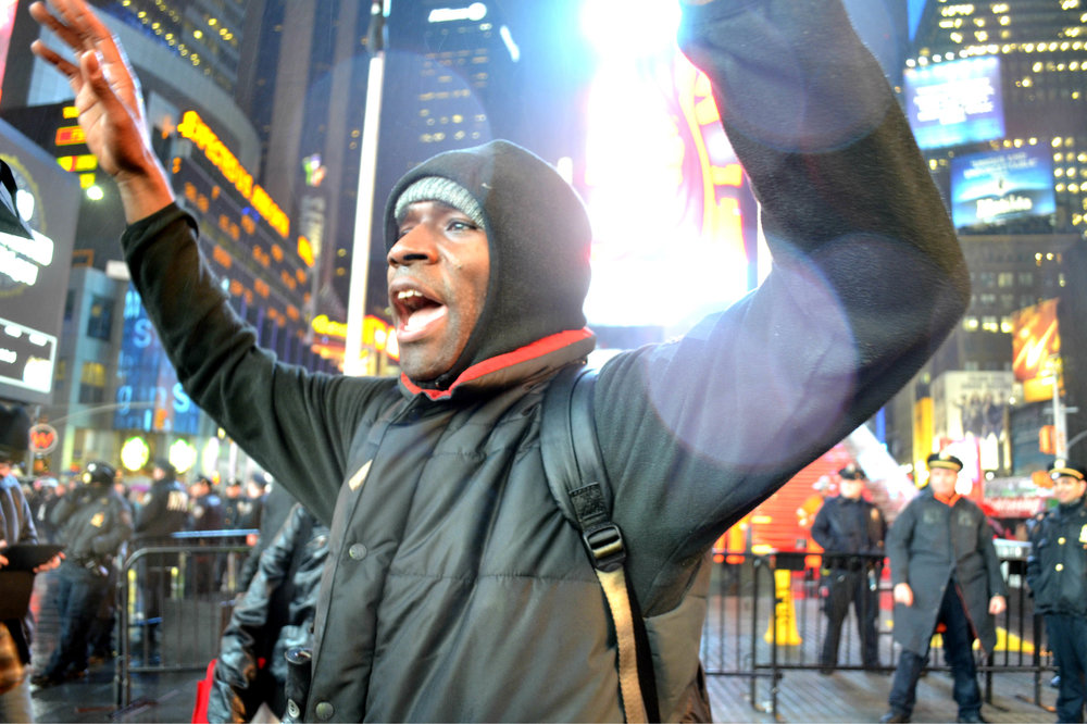 A protester chants in Times Square on Dec. 5, 2014, the third night of protests after the grand jury decision on Eric Garner's death.
