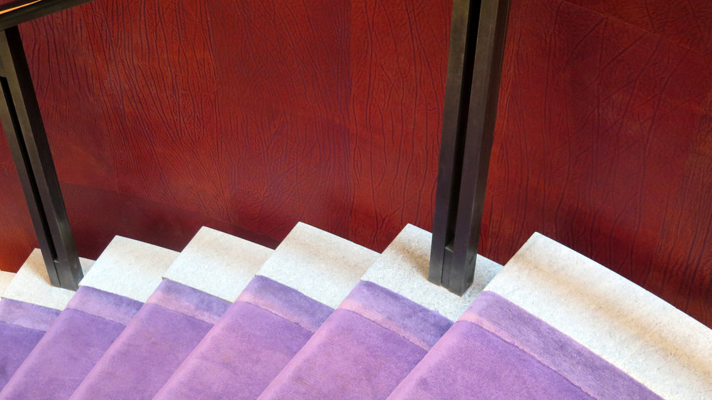 The unusual purple carpets are a nod to a Past Master of the company and an unusual history. Mr William Henry Perkin, invented the first synthetic dye at the precocious age of 18. This purple dye - named Mauveine - was the first aniline dye in production. These dyes are still used to colour leather to this day, an example of which can be seen on the walls