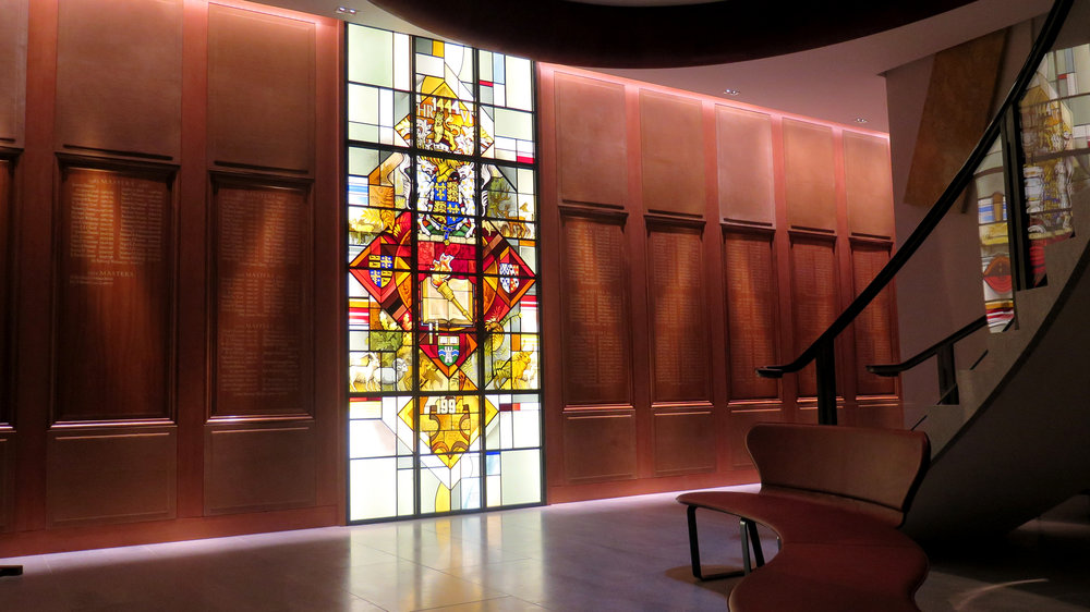 Stained glass and hardwood panelling, listing the names of all the Past Masters.