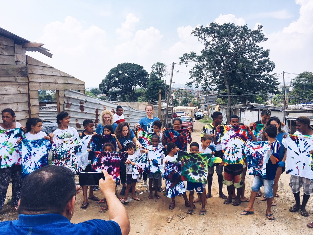 The Kids First team with the children of the favela