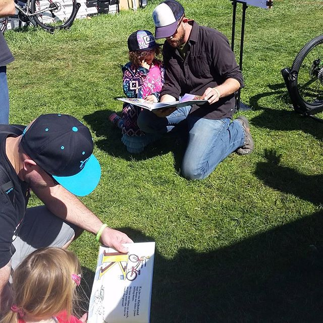 Gas to drive to SeaOtter, hotel, entry fees, etc = $xxxx. 2 dads reading #bisforbicycles  to their 2 daughters. Priceless!