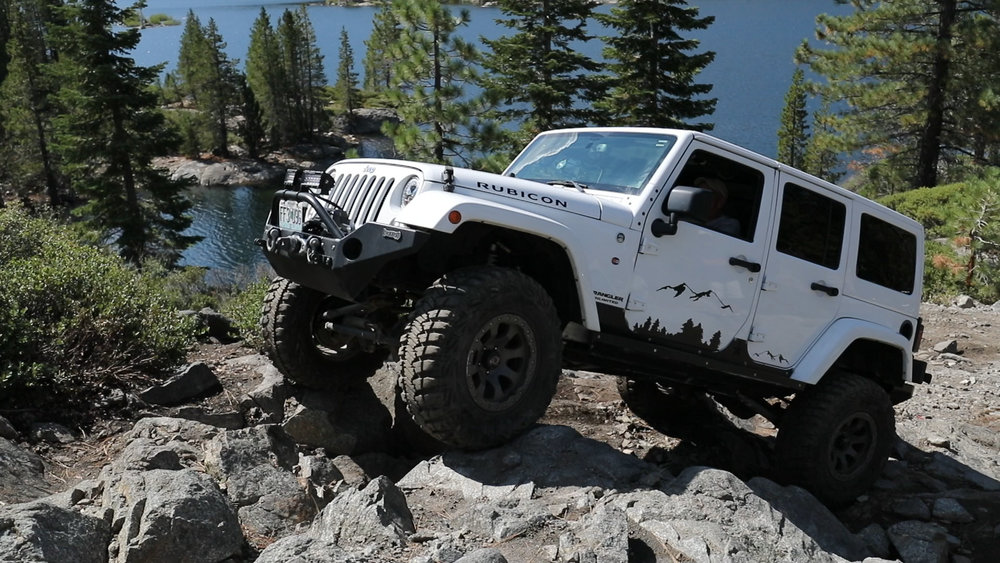 Rubicon White Jeep by lake.jpg