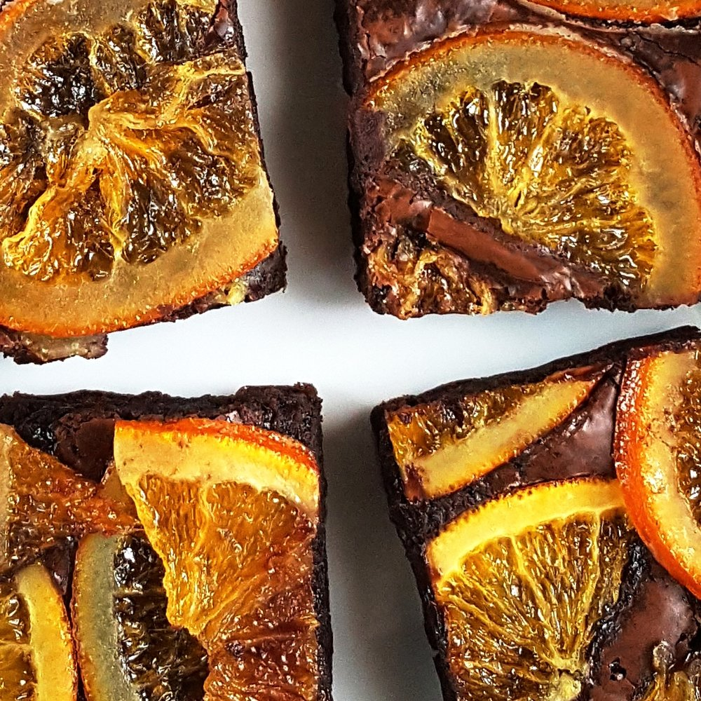 "CITRUS A-PEEL who says orange and chocolate can't be friends? our ""oh fudge!"" brownie topped with slices of freshly candied oranges. it's a refreshing combination that sings summer and will surely put a zing in your step."
