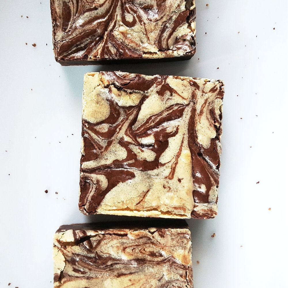 "THE CROWD PLEASER this is the ultimate satisfaction for those who want the best of both worlds. our ""oh fudge!"" brownie joins forces with our ""cookie d'oh"" blondie, creating a flavor explosion that will, well, please any crowd."