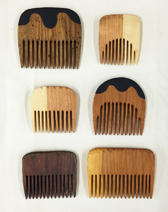 Small hand-carved combs   Knot-free wood for knot-free locks. These combs are carved with love and feel smooth and stimulating on your lucky scalp. Woods include butternut, cherry, and walnut, with milk paint detail.