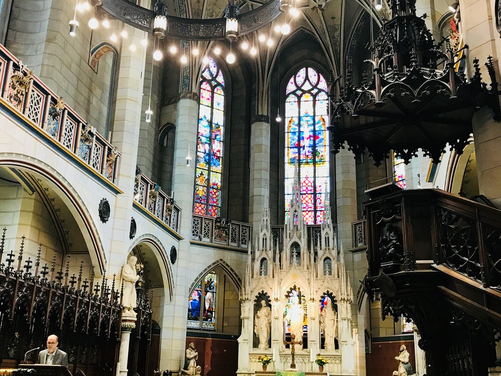 Marlowe Society of America President Kirk Melnikoff delivers the opening address in Wittenberg's magnificent Schlosskirche. (Luther is buried underneath the pulpit on the right.)