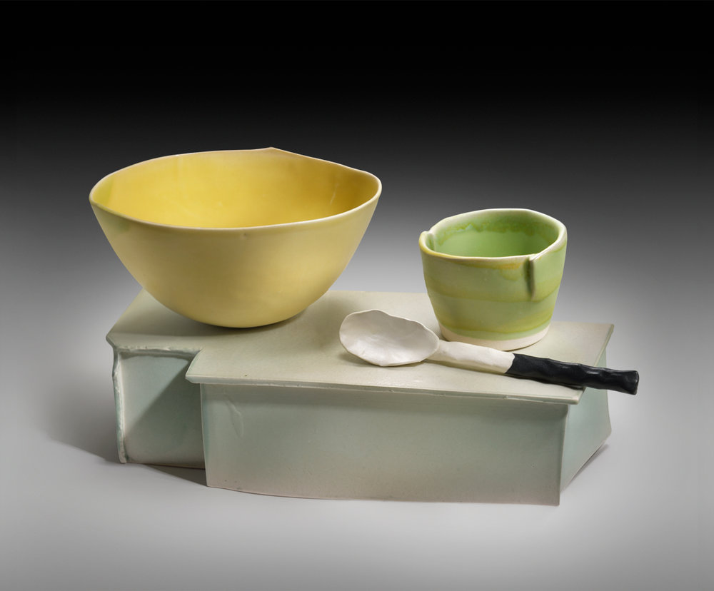 Two Bowls With Spoons On Base