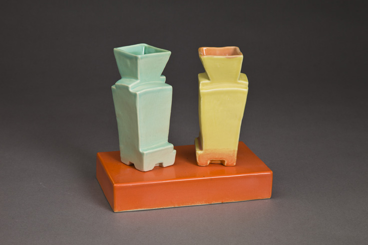 Two Faceted Vases On Base