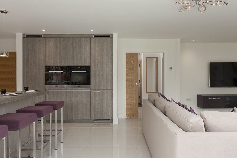 Open living room and kitchen dining area. Polished porcelain tiling throughout ground floor to provide a contemporary and clean aesthetic to the interior living space.