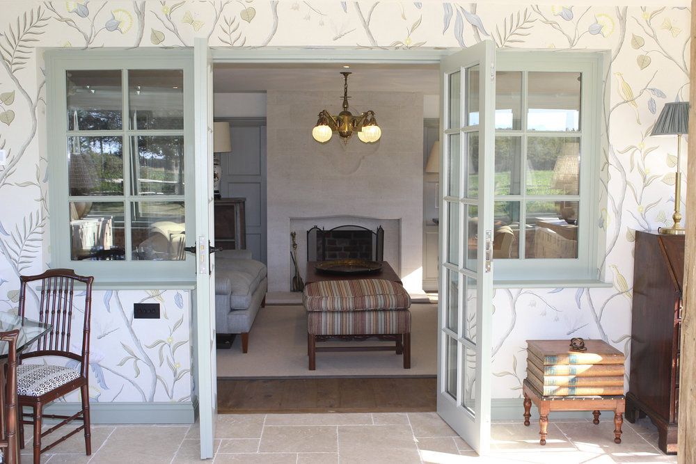 View from conservatory into drawing room showing the beautiful Lewis & Wood wallpaper