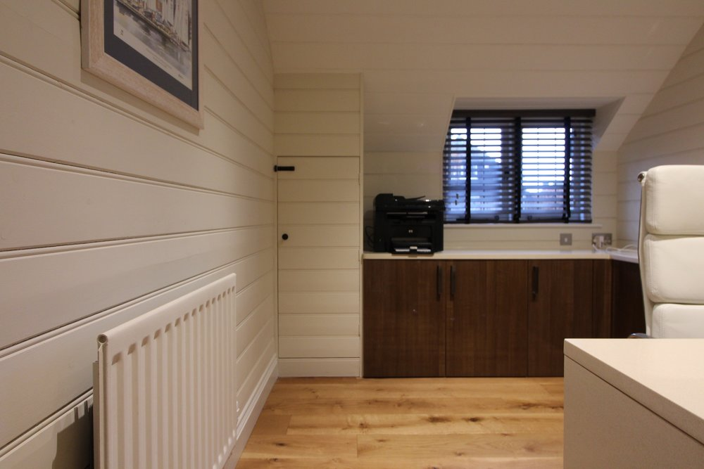 Bespoke office with tongue and groove panelling, in keeping with the rest of the home.