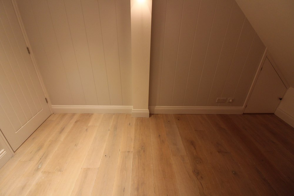 Solid oak floor covers water feed underfloor heating.
