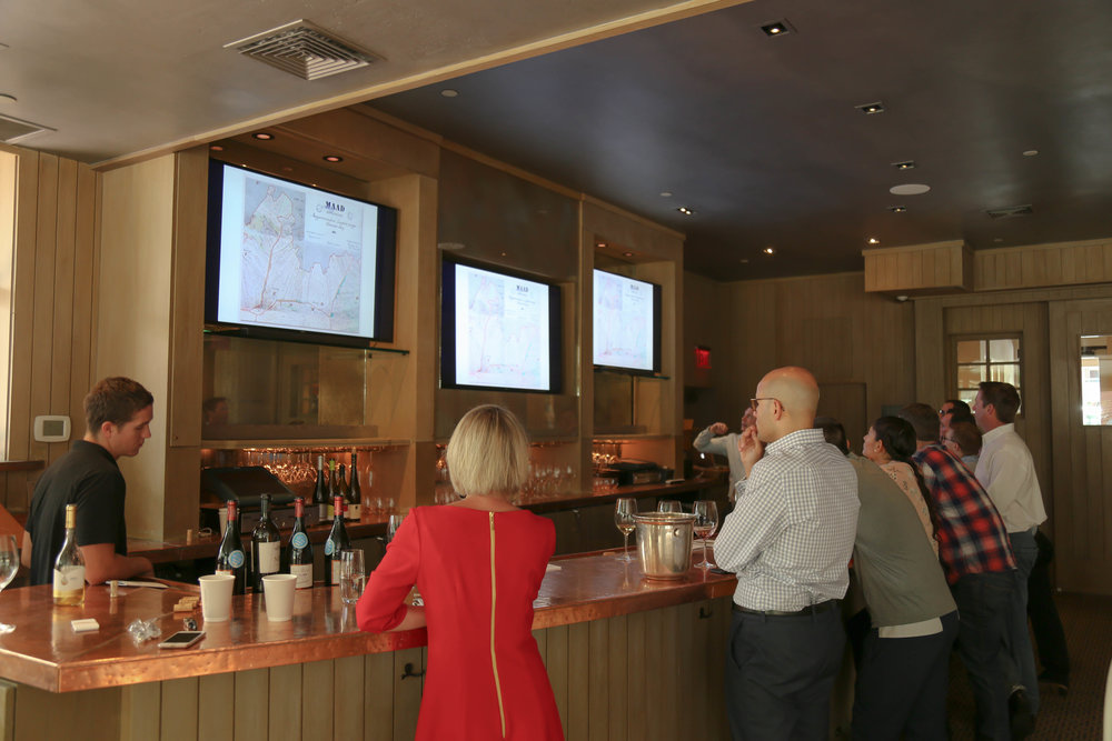 Watching closely are Carlton McCoy, MS and Wine Director at The Little Nell, Petra Hajdú, official from the Hungarian National Trading House.  /Everyone was extremely interested in the 1867 map of the vineyards of the village of Mád/