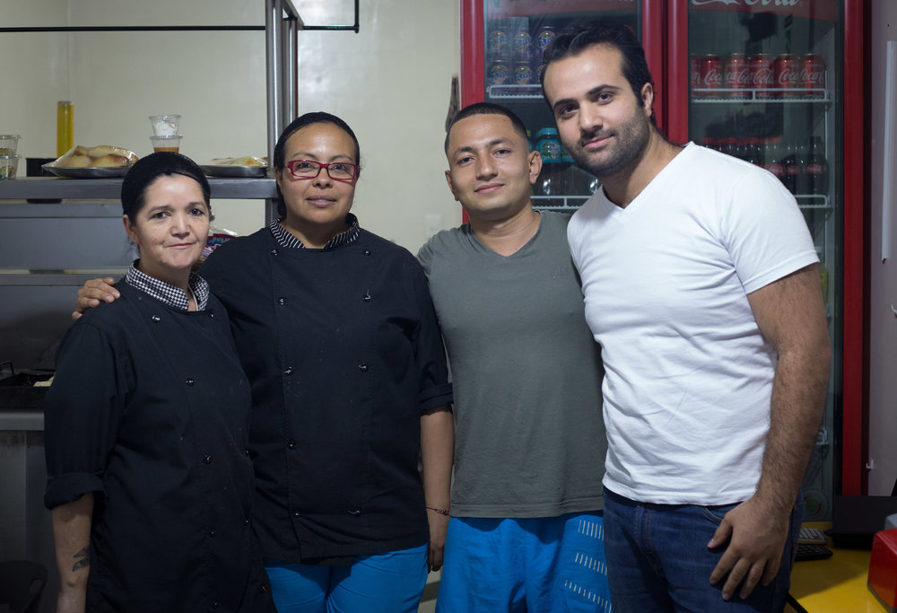 Almotaz (far right) and his team of three employees.