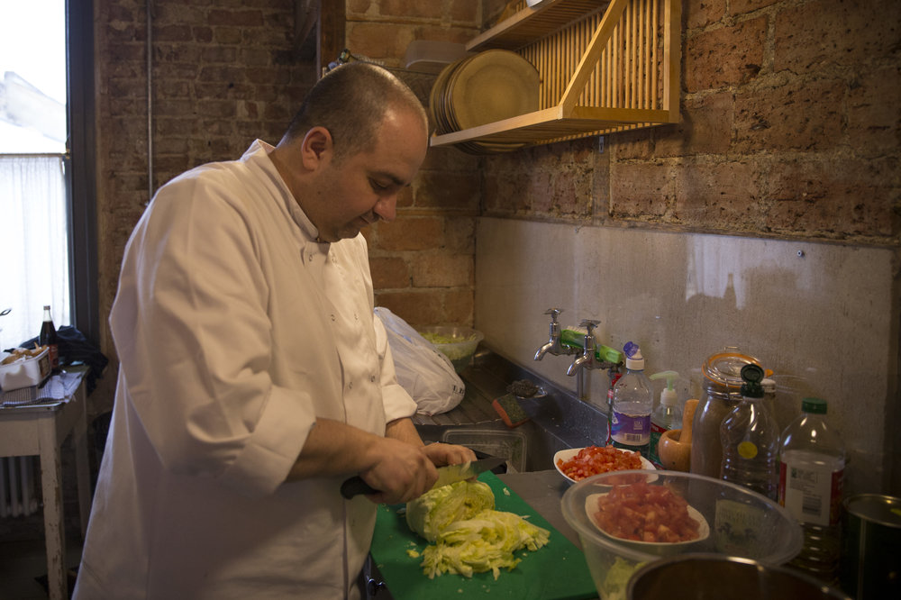 Imad Alarnab cooks his way from Demascus to London - 15 March 2017 - Cue: The UK has resettled 4,500 Syrian refugees. Their journey here is often harrowing, but what is it like once they arrive and begin trying to piece together a normal life again?Imad Alarnab is now a car salesman in London, but he once owned two restaurants and several juice bars in Damascus. This week and next week he is hosting a pop-up Syrian restaurant on Columbia Road, east London, as he works toward building a life that he loves in the UK - and what he loves, is cooking. Cady Voge reports--15 March 2017 [Read the print piece here]