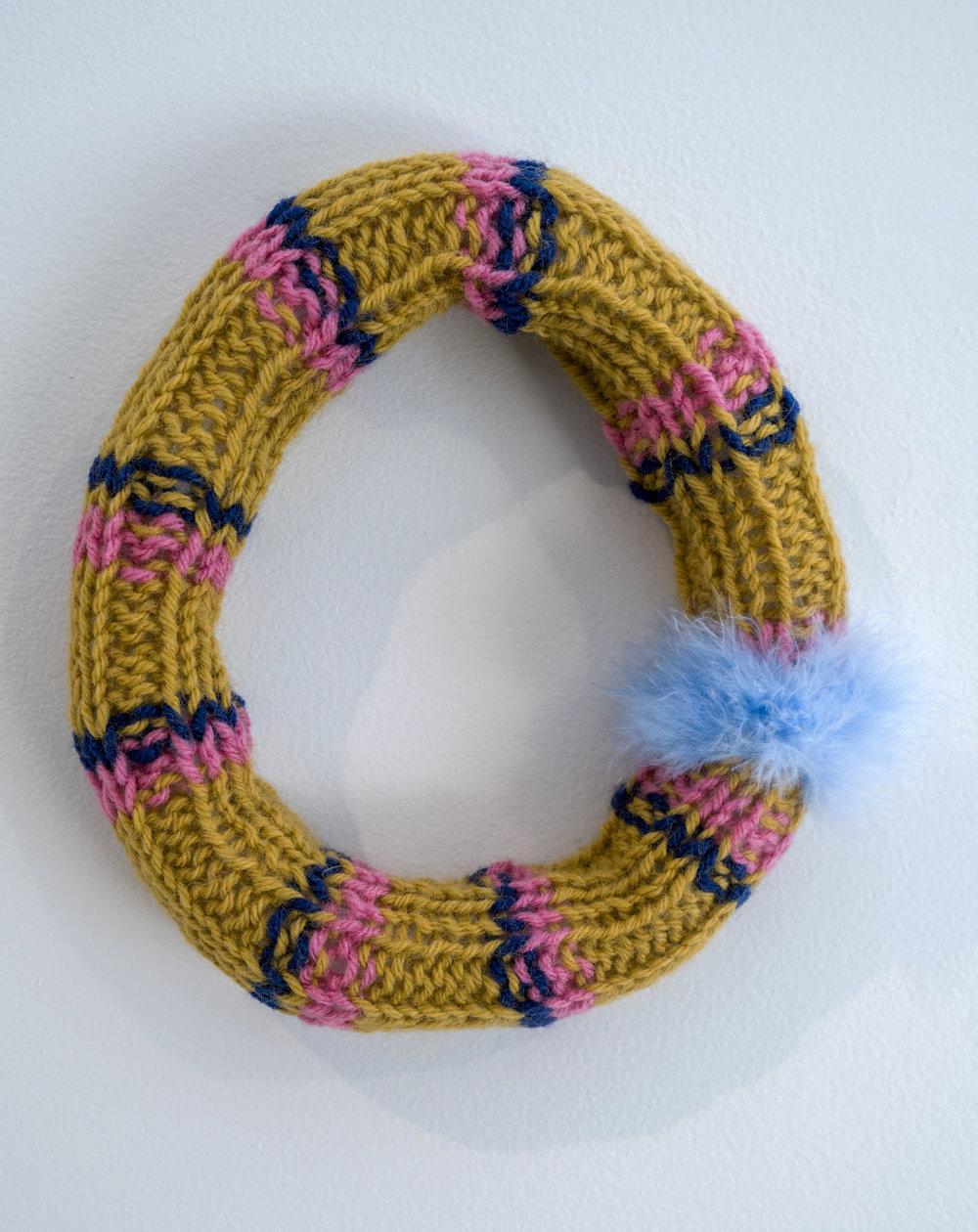 """Ring around the rosie   2016  Wool yarn, acrylic yarn, acrylic stuffing,feather down.  8"""" x 8"""""""