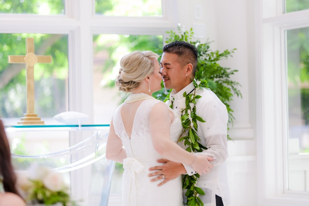 Wedding Ceremony - First Kiss. Wedding chapel at the Hawaiian Hilton Hotel in Waikiki Oahu