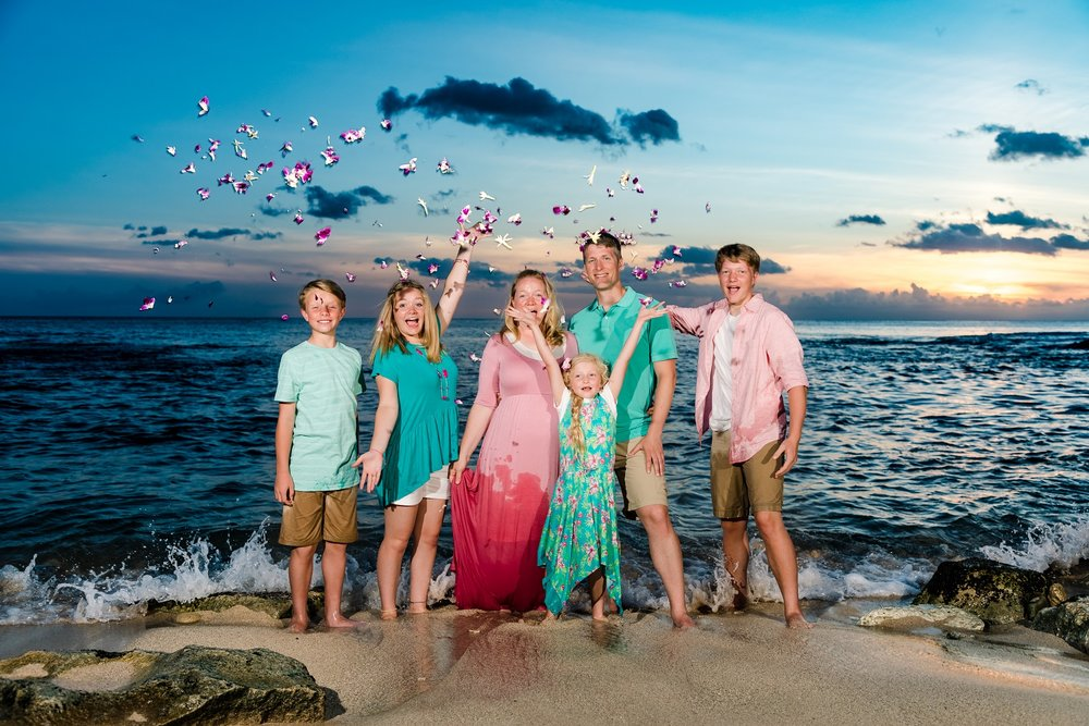 sunset beach family portrait flying flowers