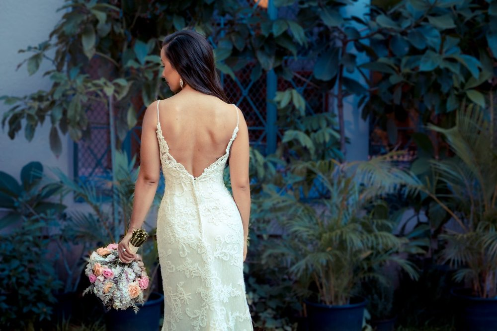 Bridal portrait, inner courtyard after sunset, flash used