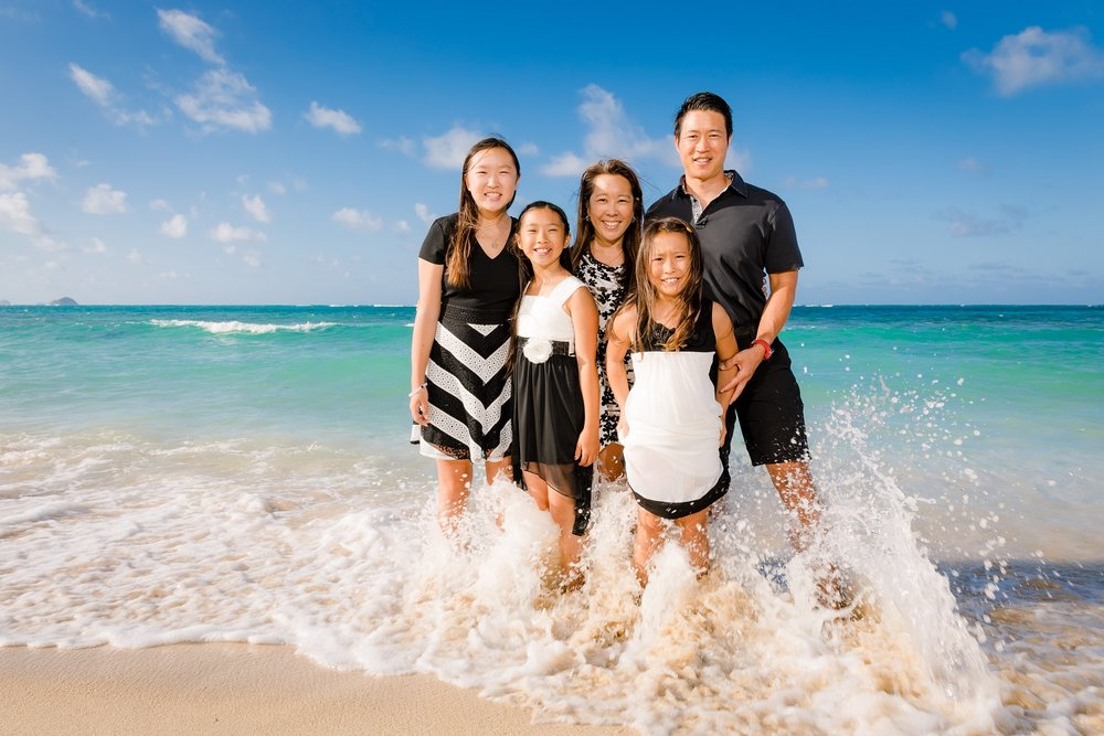 family beach portrait in the waves of maui